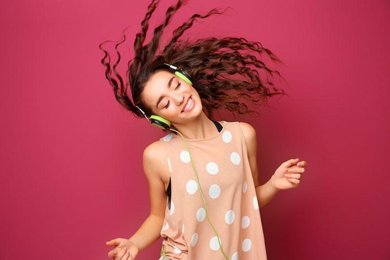 bigstock Beautiful young woman in headp 173674238 e1585677490213