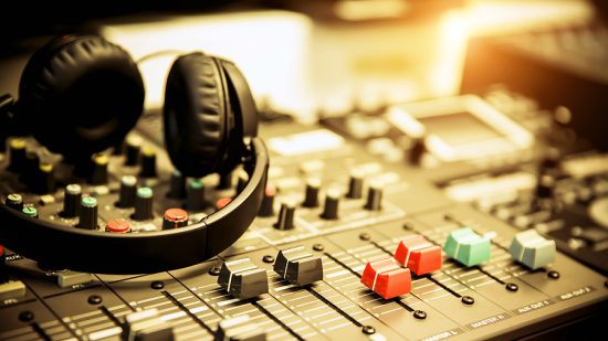 bigstock Close up Headphone And Audio M 399219677 e1608140826874