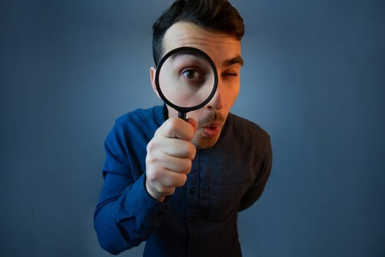 bigstock Curious Young Man With Magnify 333799513 e1603807953232