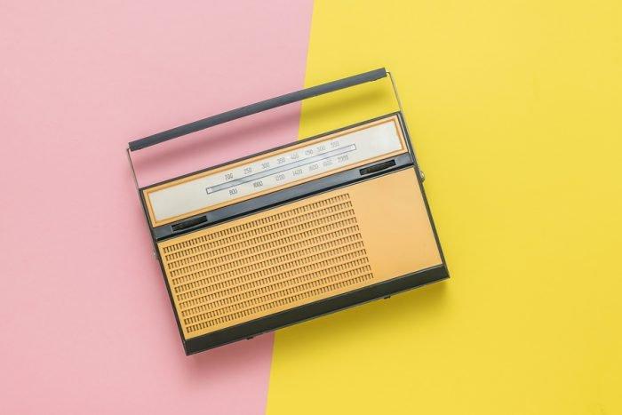 bigstock Retro Radio On A Yellow And Re 372187084 1 e1592926431668