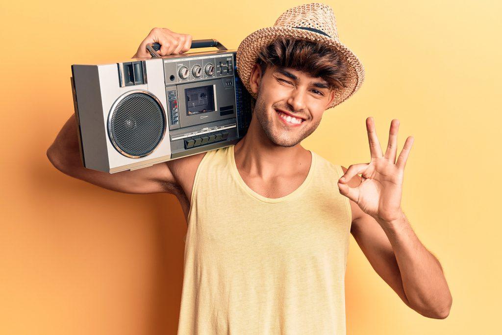 bigstock Young hispanic man holding boo 373959118 1024x683 1